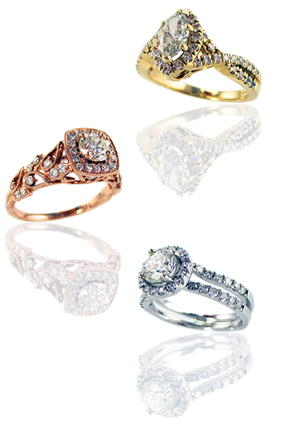Three rings. A gold ring, a silver ring and a copper colored ring.